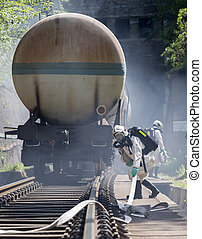 Toxic chemicals acids emergency train firefighters - A team...