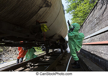 Toxic chemicals and acids emergency team checking tank - A...