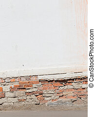 old white wall with bricks and floor