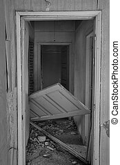 unhinged door abandoned house - Abandoned house hallway with...