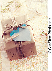 Gift Box with heart-shaped tags - Heart-shaped tags and hand...