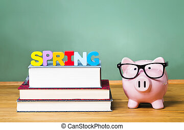 Spring Semester theme with textbooks and piggy bank and...