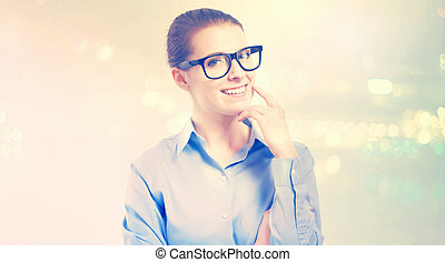 Young professional woman in glasses on abstract light...