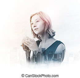Double exposure of young woman holding tea cup with city...