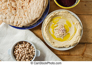 Middle Eastern cuisine: freshly made hummous, a spread made...