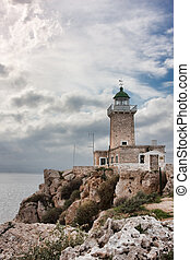 Lighthouse at Cape Ireon in Corinth bay in Greece