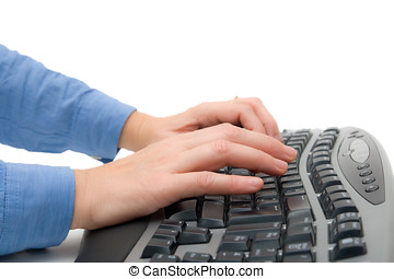 Close up of female hands working on a computer keyboard