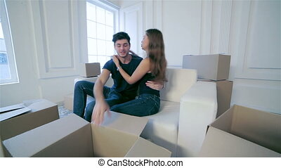 Couple in love enjoys a new apartment - Moving, repairs, new...