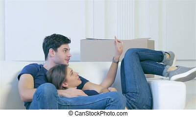 Man and woman hugging together in an empty apartment -...