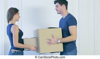 Couple girl and the guy moving - Moving, shifting, new...
