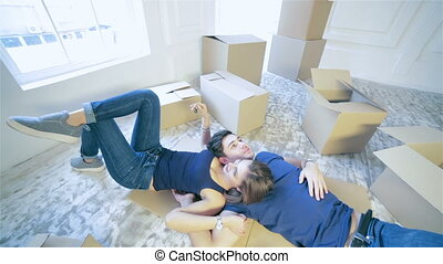 Couple holding the keys to the apartment - Moving,shifting,...