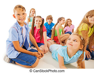 Funny 8 year old kids hang out, sitting laying down,...