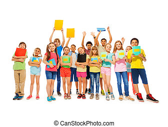 Large group of school kid standing with notebooks in fool...
