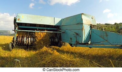 Tractor Baler Collecting Straw Left By Combine At Stubble...