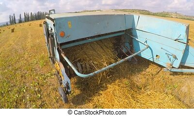 Tractor Trailer Collecting Hay Left By Combine At Stubble...