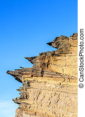 volcanic stone formation with blue sky at el Golfo