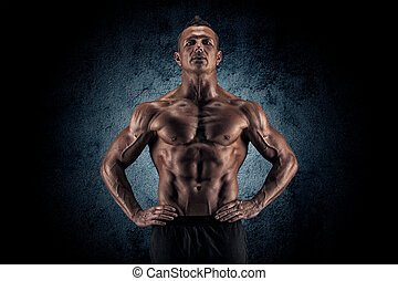 Muscular guy on black background - Sexy muscular guy in the...