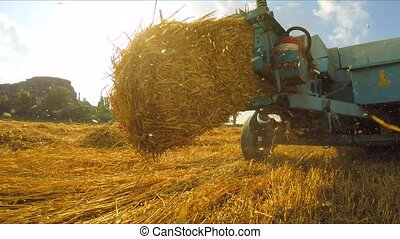 Trailer Of Tractor Making Bales Of Hay - CLOSE UP. Bales of...