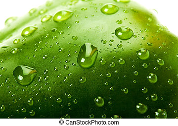 Green bell pepper with water droplets - macro picture of a...