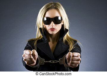handcuffed woman - sexy woman with handcuffs on