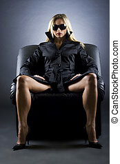 woman sitting on a luxury chair