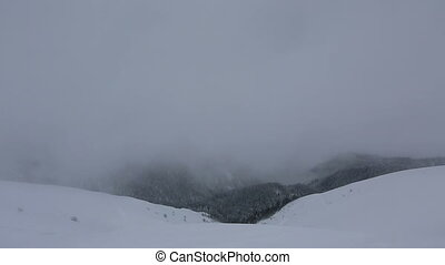 Beautiful mountain peaks of Caucasus Mountains in the fog. Time Lapse