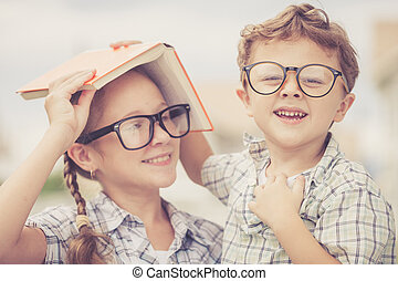 Portrait of Beautiful school boy and girl looking very happy...