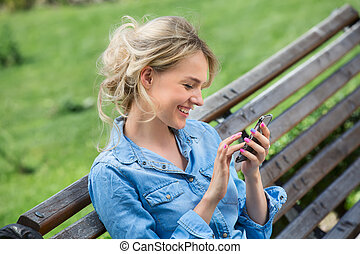 Cute blonde talking on a cell phone - Cute blonde in a...
