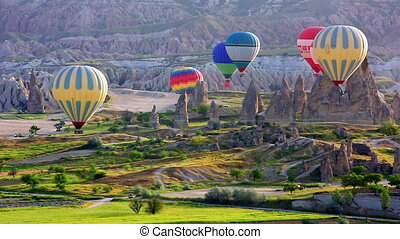 Multi-colored balloons fly over rocks.The greatest tourist...