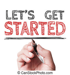 Let us get started - Hand with pen is writing the text Let...