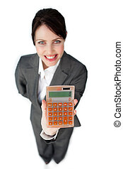 Cheerful businesswoman holding a calculator isolated on a...
