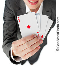 Close-up of a businesswoman holding all the aces against a...