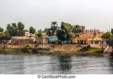 Nile village - a horizontal view of a little village at he...
