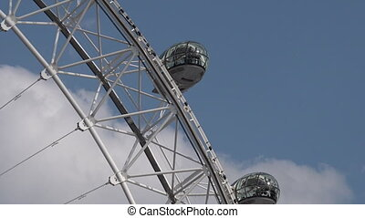 London Eye Millennium Wheel - Visitors in a ovoidal capsule...