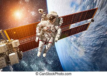 International Space Station and astronaut. - International...