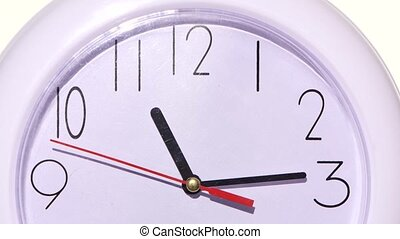 isolated white clock. close up of an office clock on white...