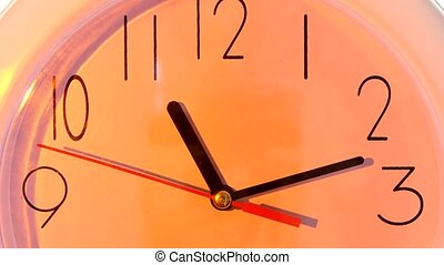 isolated orange clock close up, hours day - isolated orange...