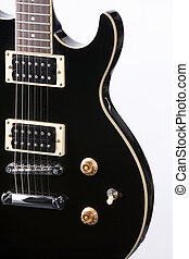 Electric Guitar Isolated On White - A piano black electric...