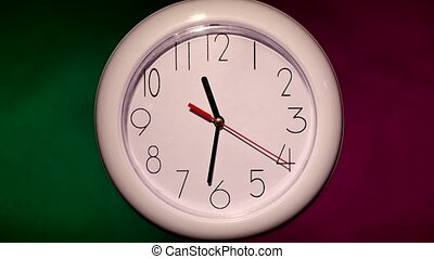close up of an white office clock on colorful background -...