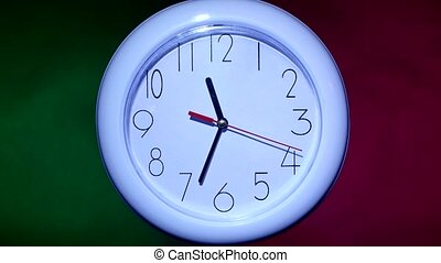 close up of an white clock on colorful background - close up...