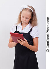 Portrait of teen girl with calculator on white background -...