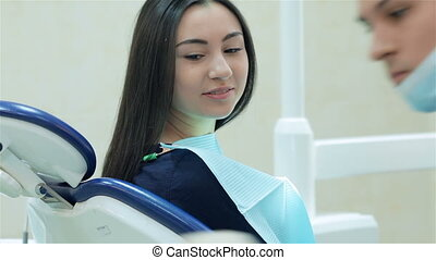 The dentist and the patient prior to dental treatment The...