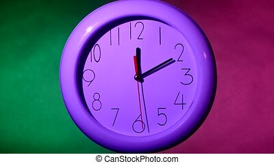 white clock on colorful background, night - close up of an...