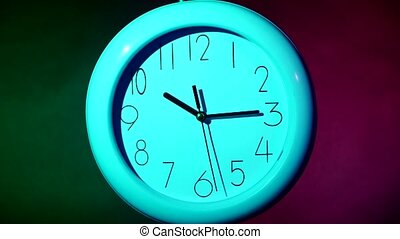 blue Clock on color wooden plank wall - Clock on color...