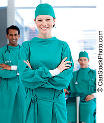 Confident surgeons smiling at the camera in a hospital
