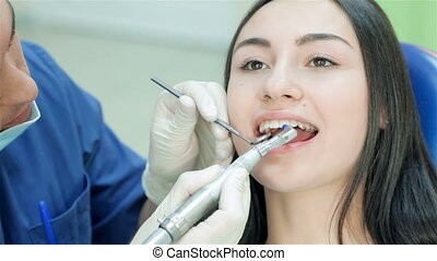 Dentist finishes viewing teeth patient girl - Portrait of...