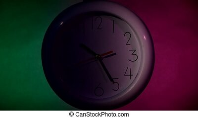 white Clock on color wooden plank wall, night Light