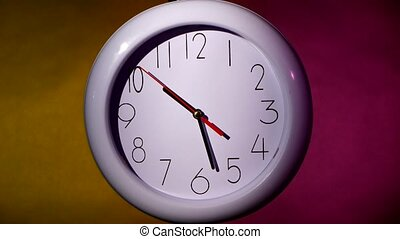 white clock on colorful background - close up of an white...