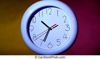 close up of an white clock on colorful background