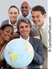 Joyful business group showing ethnic diversity holding a...